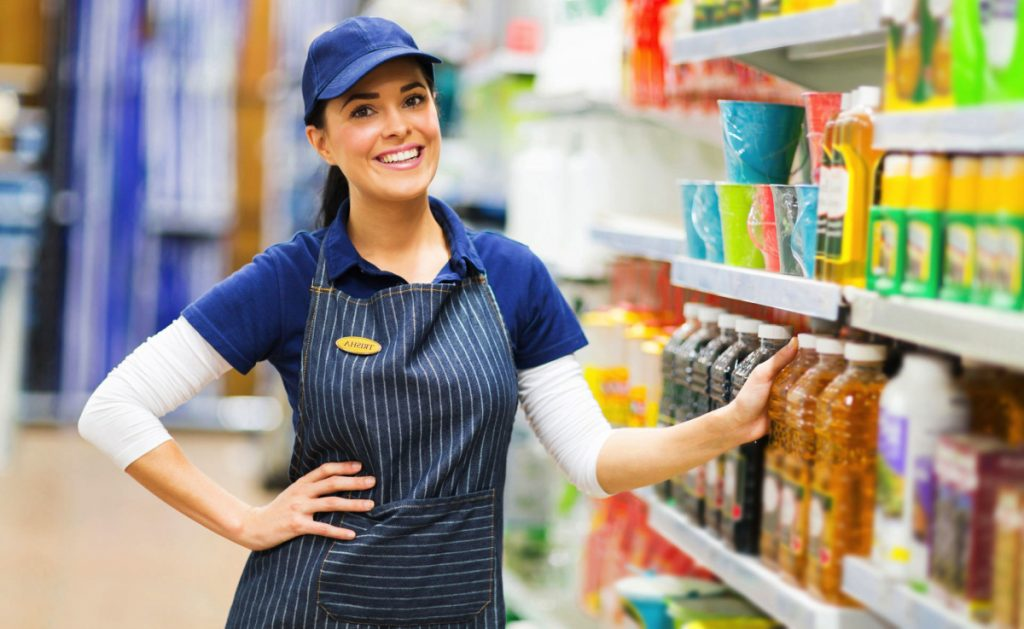 supermarket saleswoman standing in store